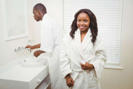 bathrobes: Ethnic couple wearing bathrobes in the bathroom