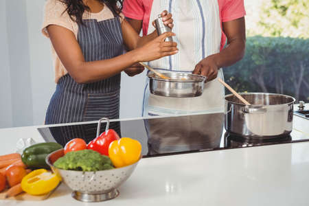 ethnic couple: Ethnic couple cooking in the kitchen