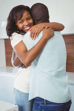 ethnic couple: Ethnic couple hugging in the kitchen