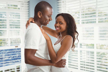 ethnic couple: Ethnic couple hugging in the living room