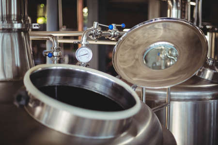microbrewery: Focus on large vat at the local brewery LANG_EVOIMAGES