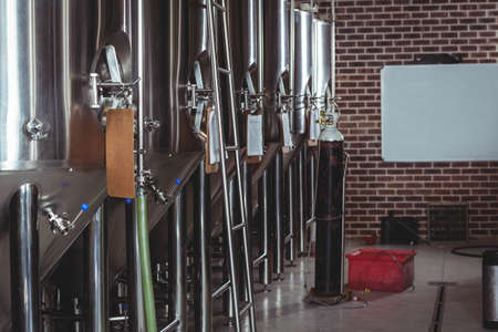 microbrewery: Large vats of beer at the local brewery LANG_EVOIMAGES