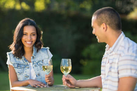 flute structure: Happy couple drinking champagne in garden