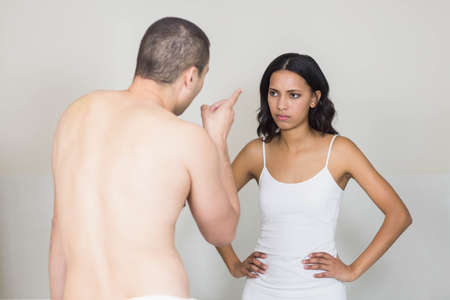 couple bathroom: Unhappy young couple arguing in bathroom LANG_EVOIMAGES