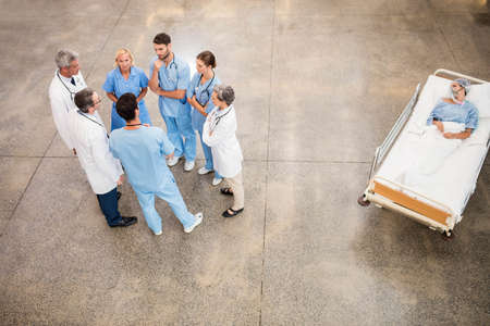 hospital trolley: Medical team with patient on trolley at the hospital LANG_EVOIMAGES