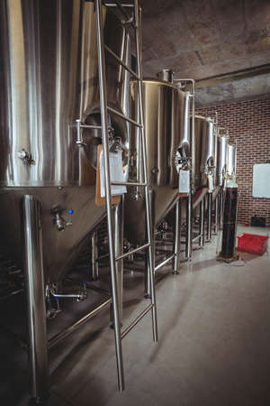 microbrewery: Large steel vats for beer at the local brewery