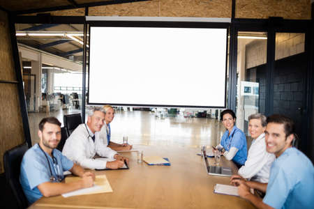 video chat: Business team using video chat during meeting at the office