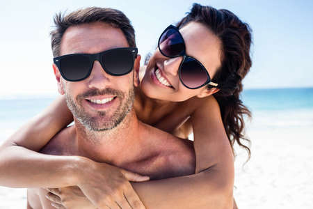 arms around: Cute couple hugging with arms around on the beach