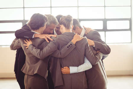 huddling: Business team huddling at the office
