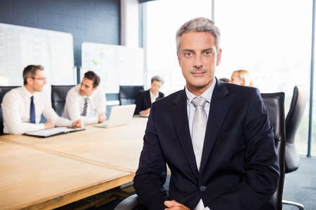 management team: Businessman smiling at the camera during meeting at the office
