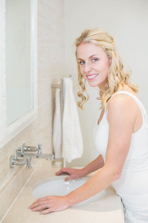 taking care: Beautiful woman taking care of herself in the bathroom