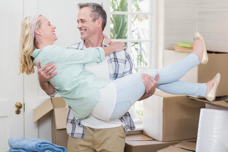 sealing tape: Happy husband carrying his wife in their new house