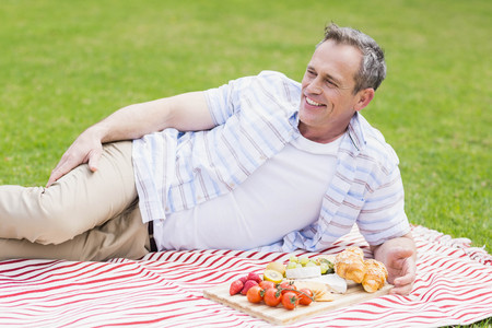greenness: Happy man having a picnic outside