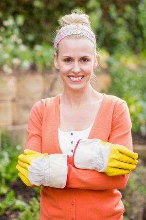 gardening gloves: Cute woman wearing gardening gloves in the garden