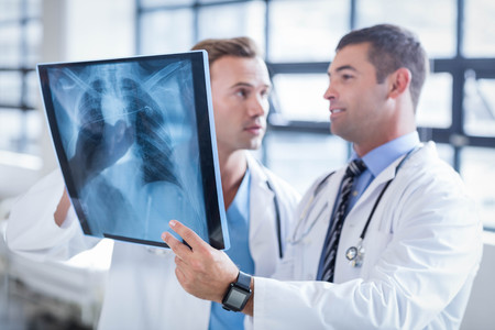discussion: Doctors discussing an xray at the hospital