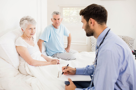 giver: Handsome nurse visiting a mature woman at home