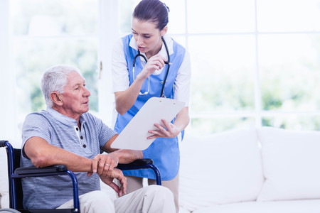 care home: Doctor checking patients health at home