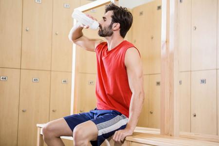 man drinking water: Handsome man drinking water