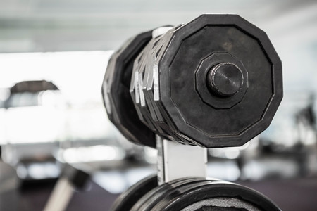 weight room: A close up of some weights in a gym