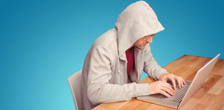 hooded shirt: Businessman with hooded shirt working on laptop against blue vignette background