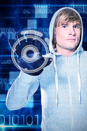 black gloves: Man with black gloves staring at camera against blue technology design with binary code Stock Photo