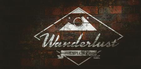 wanderlust: Wanderlust word against texture of bricks wall