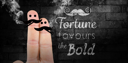 favours: Two fingers with mustache against texture of bricks wall