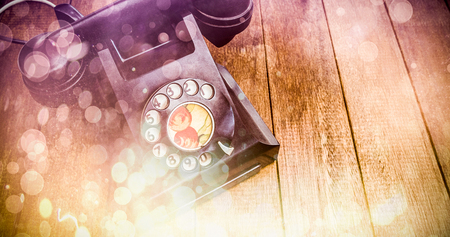 turn dial: Pink abstract light spot design against view of an old phone