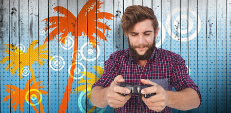 playing video game: Hipster playing video game against wooden planks background