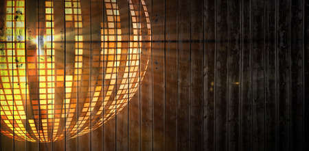digitally: Wooden planks background against digitally generated cool disco ball design