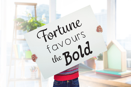 favours: Hipster woman behind a big white card against view of a business desk Stock Photo
