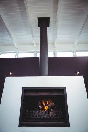 fireplace home: Fireplace set in wall in a home