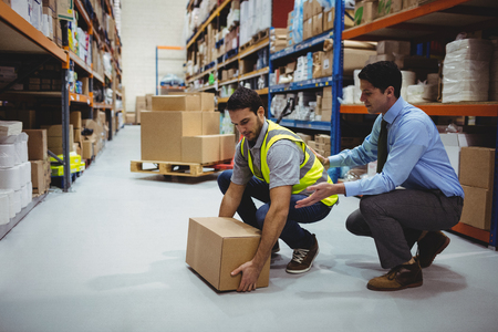 Manager training worker for health and safety measure in a large warehouse Stock Photo