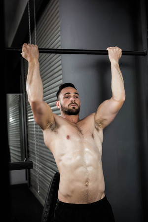 pull up: Shirtless man doing pull up at the crossfit gym