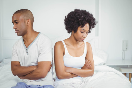 not talking: Upset couple not talking after argument sitting on bed Stock Photo