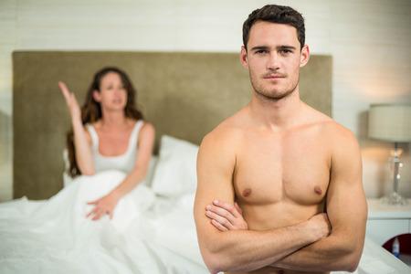 glum: Upset couple having an argument in the bedroom Stock Photo