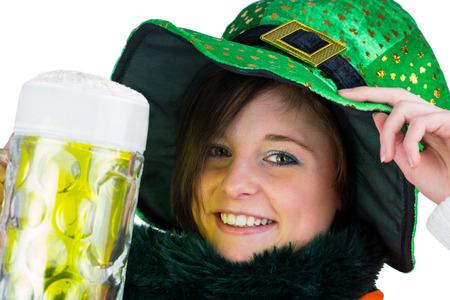 st  patty: Pretty brunette celebrating Saint Patricks day on white background