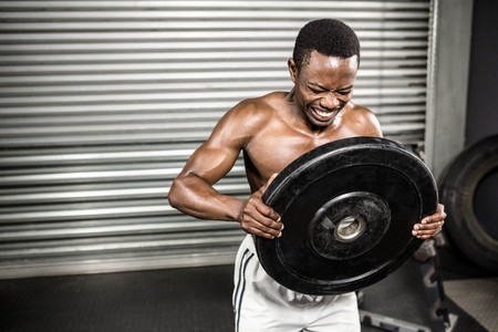 heavy weight: Shirtless man holding heavy weight at the crossfit gym Stock Photo