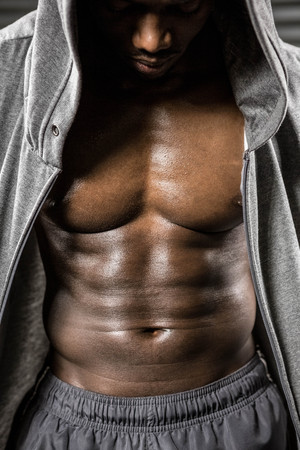 jumper: Standing shirtless man with grey jumper at the crossfit gym Stock Photo