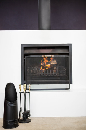 View of fire place in a living room Stock Photo