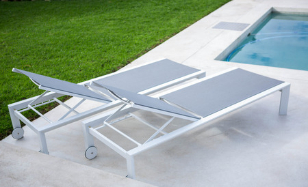 domiciles: Deck chair by the pool on a sunny day