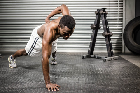 push up: Shirtless man doing push up at the crossfit gym Stock Photo