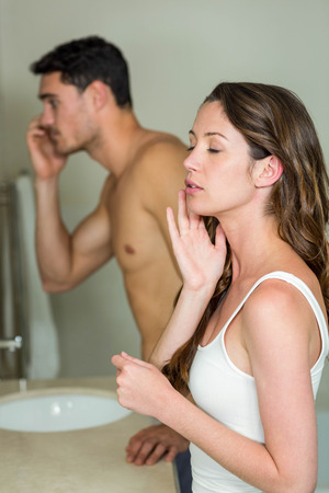 couple bathroom: Couple looking in bathroom mirror in the morning Stock Photo