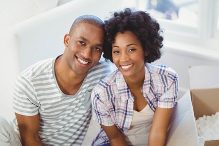 unpack: Happy couple opening boxes in the living room Stock Photo