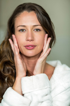 day dreaming: Portrait of beautiful brunette woman day dreaming in bathroom