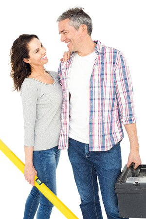 bubble level: Couple with toolbox and bubble level on white background Stock Photo