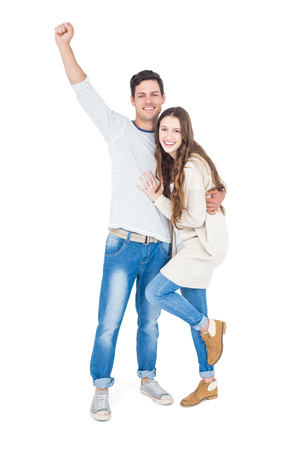 triumphant: Triumphant couple raising fist on white background