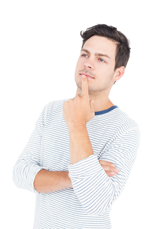Thoughtful man with hand on chin on white background