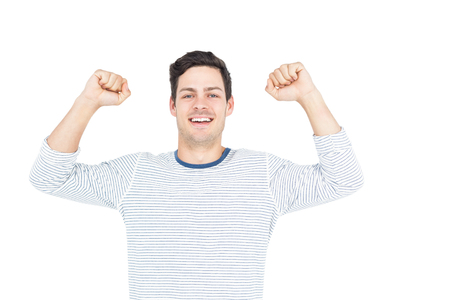 triumphant: Triumphant man raising fist on white background