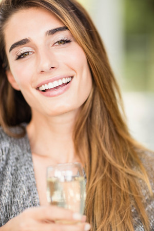 champagne flute: Portrait of beautiful woman smiling and having champagne flute